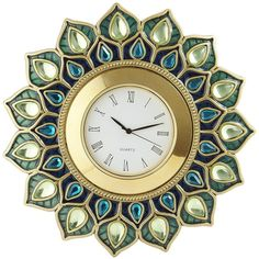 At last, a clock that relishes being watched. Inspired by the colorful plumage of the peacock, this pretty timepiece rests on its support, which folds easily f…
