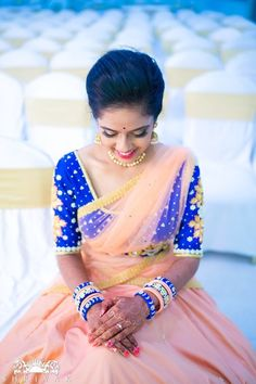South Indian Brides - Beautiful Bride in a Peach Saree | WedMeGood | South Indian Bride in a Peach Saree with Royal Blue Threadwork Blouse  #wedmegood #indianbride #indianwedding #peach #blue #saree #net #southindianbride