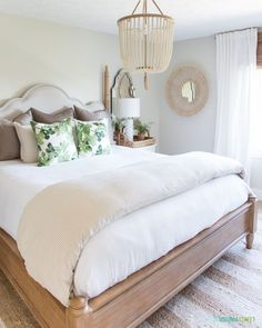 Loving everything about this space with a wooden beaded chandelier striped duvet cover palm leaf pillows fiddle lead tree and rattan mirror! Gorgeous Neutral & G Home Bedroom, Guest Bedroom Decor, Bedroom Interior, Bedroom Design, Green Bedroom Decor, Interior Design Bedroom, Bedroom Decor, Bedroom Green, Home Decor