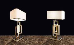 Edge table lamp by Oasis, design by Massimiliano Raggi. LED lights diffused by a structure of aluminum, bronze and antiqued gold.