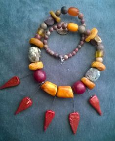 Mixed strand that holds as focal pieces artisan ooak made ceramic hot pepper or arrow shaped pieces absolutely beautiful. The strand has
