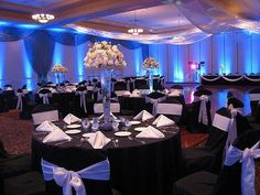 Black and White Wedding Theme,  Lake Receptions.  Kristin!  What do you think about gettings some blue uplights on the columns in Symphony Ballroom similar to this?