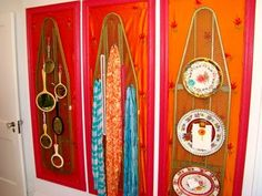 Remove the legs from a metal ironing board - hang on the wall - add hooks - hang jewelry <3
