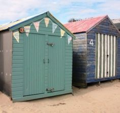 beach hut with painted bunting, but would be cute on the garden shed too ~