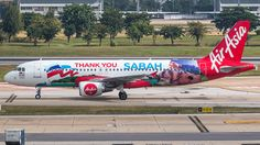 AirAsia (MY) Airbus A320-216 9M-AHT aircraft, painted in ''Thank you Sabah'' special colours Nov. 2014, (1st version), skating at Malaysia Kuala Lumpur Sepang International Airport. 11/02/2017.(Sabah=one of the two states on the island of Borneo).