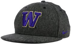 Show your college team pride with the style of the Washington Huskies True Tweed Snapback cap. A raised team logo is embroidered at front, and a Nike swoosh at the left side complements the team colors while telling the world you don't settle for less than the best. High crown Structured fit Normal bill Raised embroidered team logo at front Nike swoosh logo at left side Snapback closure Polyester/cotton/wool/rayon Spot clean only