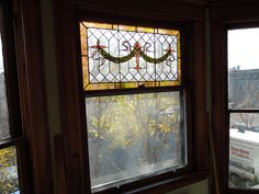 Stained glass double hung window.  Weather stripped with tilt-in feature by Borden Window.