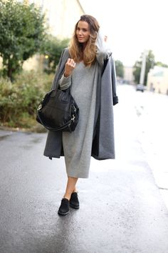 Annette Haga layers grey jacket over grey midi dress with simple black lace ups. Jacket: Gestuz.