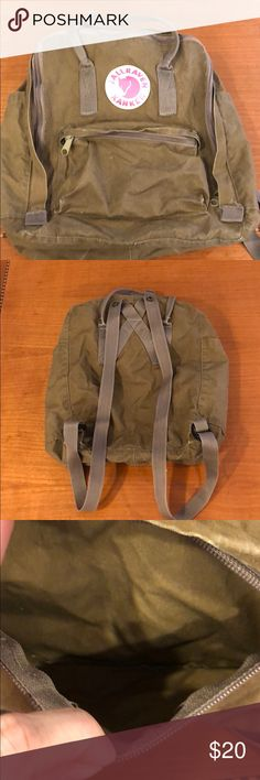 fjallraven kanken olive backpack Used fjallraven kanken backpack.  Has been washed twice, but still holding up very nice.  Purchased in Sweden over 10 years ago.  This backpack has the soft top handle NOT the stiff top handles. Fjallraven Bags Backpacks