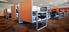 Knoll Accela Project in San Ramon, CA.  Vibrant orange revs up the workstations.
