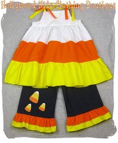 Custom Boutique Clothing Candy Corn Tiered Twirl Top Denim Ruffle Pant Bottom Outfit Set 3 6 9 12 18 24 month size 2T 2 3T 3 4T 4 5T 5 6 7 8. $47.99 USD, via Etsy.