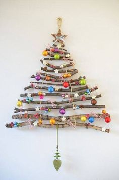 Christmas tree for the wall made of sticks Stick Christmas Tree, Easy Christmas Ornaments, Homemade Christmas Decorations, Alternative Christmas Tree, Christmas Ornaments To Make, Xmas Decorations, Simple Christmas, Christmas Diy, Handmade Christmas