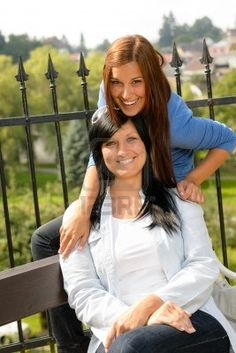 Mother and daughter in the park smiling teen together loving Stock Photo
