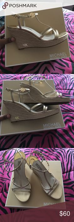 Micheal Kors gold wedge sandals Wedge gold sandals never worn as sticker notes on picture at the bottom of the shoe.  Very cute to dress up jeans, dresses and skirts. Michael Kors Shoes Wedges