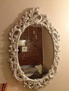 Hollywood Regency Mirror Rococo Revival Frame White Lacquer Oval. $110.00, via Etsy.