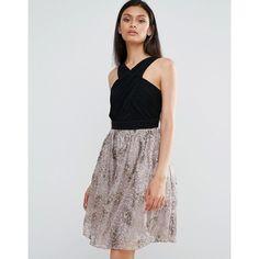 Little Mistress Skater Dress With Contrast Metallic Skirt ($39) ❤ liked on Polyvore featuring dresses, black, skater dress, high neck dress, cross front dress, sequined dresses and fit and flare skater dress