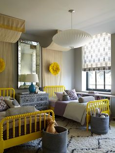 Girls twin bedroom with yellow accents