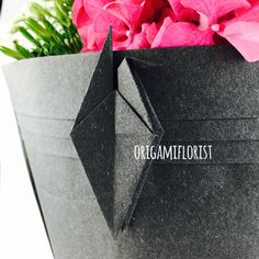 Incorporate origami art into bouquet packaging. Simply elegant !