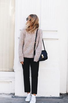 Business fashion | Neutral sweater, black trousers, white sneakers and a black purse