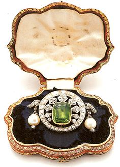 Peridot, diamond, pearl, silver and gold brooch, made by Freres, Paris, for Empress Eugenie, wife of Emperor Napoleon III, circa 1864.
