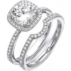 This gorgeous 18K white engagement ring and band is comprised of .55ctw round white Diamonds.