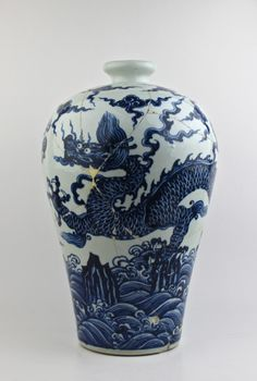 A RARE EXAMPLE OF MING DYNASTY 15th CENTURY B/W MEIPING WITH A DRAGON CHASING FLAMING PEARL.
