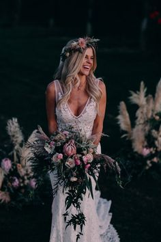 This boho bride is lookin' gorgeous with her matching bouquet and bridal crown | Image by Corey Lynn Tucker Photography