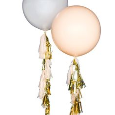 """Chic never looked so fun! Our blush and white 36"""" giant balloons get fancy for the party with gold and champagne colored tassels. Perfect as decoration or as gift for the birthday girl! Add to the bas"""