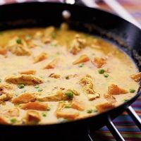 Easy Coconut Curry Chicken Recipe - Chicken Breast, garlic, ginger, Chinese 5 spice, Red Curry Powder, unsweetened cocnut milk, bamboo shoots, cilantro, thai basil & steamed rice!