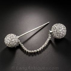 Platinum and Diamond Art Deco Jabot Pin - 50-3-2705 - Lang Antiques. This stunning and sensational jabot pin, circa 1925, will light up any room - the darker the better! Two three-dimensional (disco) balls - 14 millimeters and 12 mm. - are tightly paved with with over 200 bright white and sparkling European-cut diamonds, weighing 8.50 carats total. The two balls are connected by a 2 1/4 inch collet-set diamond chain for both beauty and safety. A truly unique and sophisticated jewel with…