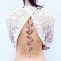 Tatto naturaleza en la espalda