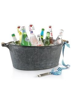 Tie a bottle opener to the handle of the drink tub or cooler. | 27 Best Summer Party Hacks