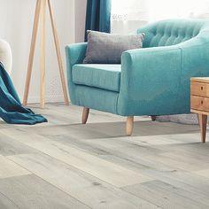 Beige, light wood-look flooring. Pergo Extreme Wood Enhanced in Moonbeam