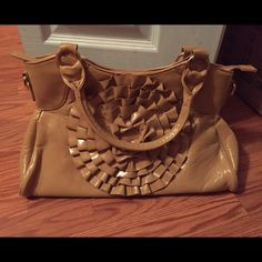Purse! For sale! Looks exactly like the picture! The inside is pink color, and tan outside. A few pockets inside the bag!!! Bags Shoulder Bags
