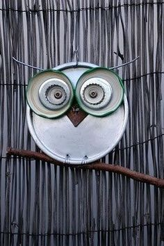 I love this! I would go great inside or out and another + is owls are in right now, and who can't find old lids?! Looks like i'm gonna be going through some junk! :O