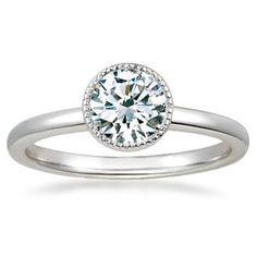 The Sierra Ring - a distinctive new style with a sparkling milgrain halo around a bezel set diamond | brilliantearth.com