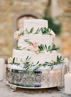 Pretty cake. Olive branches and peonies for decoration. Simple and beautiful