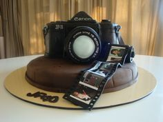 Such an awesome cake- just with a Nikon or even cooler would be a vintage camera or my old Olympus. With some of my favorite pictures!