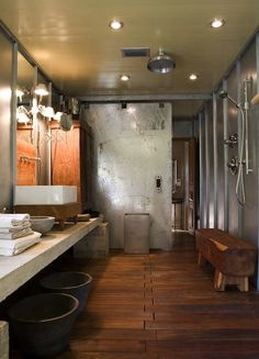 Suzie: Mell Lawrence Architects - Industrial bathroom with rain shower head, teak bench, ...