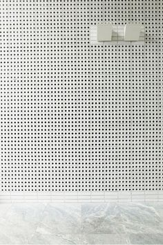 White painted perforated brick