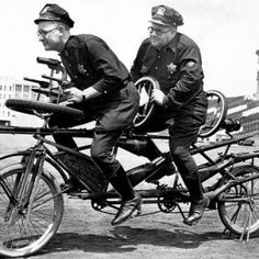 """Chicago police officers Frank Folsom, left, and Robert Williams rehearse an act on a """"sniper bike"""" for the Police and Fire Thrill Show in July Old Pictures, Old Photos, Funny Vintage Photos, Vintage Photographs, Vintage Postcards, Chicago Police Officer, Tandem Bicycle, Emergency Vehicles, Police Vehicles"""