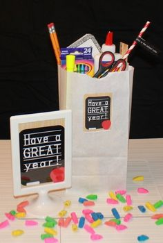 Back To School Themed Party favors for the Teachers???  Maybe more Teacher needed items like dry erase markers, good colored pens for grading, gift certificates to Starbucks, etc.