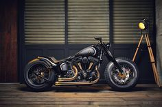 The Harley Softail Slim has two points in its favor: it's a simple bobber-style bike with a vintage vibe, and it has a super-low seat height of less than 24 inches. It's basically a Fat Boy with the fat trimmed off, and there's ample grunt from a 103ci (1688cc) Big Twin motor. This makes it the ideal platform for a custom build, and Rough Crafts has seized the bait.