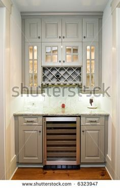 Wet Bar Butlers Pantry With Gray Cabinets Wine Rack And Granite Counter Tops