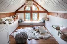 Textures abound in the attic loft, where sheepskins from Overland are layered with kilim pillows and a knit pouf, perfect for lazy lounging.
