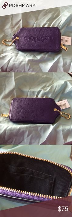 Coach hang tag utility case Beautiful deep purple pebbled leather multifunction case.  Made to look like the classics Coach hang tag.  Coach embossed logo on the front with with a gold ball beaded chain.  It can be used to fasten to inside or outside of your purse or fun just to carry.  Fits an iPhone 6.  Hard to find piece!  New with tags. Coach Bags Clutches & Wristlets