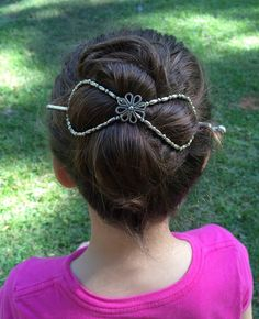 I love the simple elegance of this silver hair clip. And it sure does hold a lot of hair!