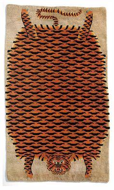 Para el piso pintado un Tibetan Tiger Rug.