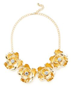 Gold floral necklace.