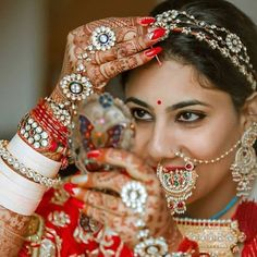 Image may contain: 1 person, closeup Asian Bridal Jewellery, Indian Jewellery Design, Indian Wedding Jewelry, Bridal Jewelry, Jewelry Design, Nath Nose Ring, Nose Ring Stud, Nose Rings, Rajasthani Dress